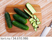 Ripe green cut cucumbers on wooden background. Стоковое фото, фотограф Яков Филимонов / Фотобанк Лори