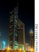 DUBAI - APRIL 18: Emirates Towers and Burj Khalifa at night time, ... Стоковое фото, фотограф Zoonar.com/Figurniy Sergey / age Fotostock / Фотобанк Лори