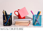 Coffee cup blank sticky note stacked books pen metal holders wooden... Стоковое фото, фотограф Zoonar.com/Artur Szczybylo / easy Fotostock / Фотобанк Лори
