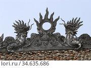 Dragons and sun temple rooftop Hua Lu ancient capital near Ninh Binh... Стоковое фото, фотограф Andrew Woodley / age Fotostock / Фотобанк Лори