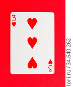 Old playing card (three) isolated on a red background. Стоковое фото, фотограф Zoonar.com/Micha Klootwijk / age Fotostock / Фотобанк Лори