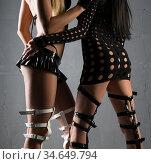 Two girls in bdsm high heel shoes cropped shot. Стоковое фото, фотограф Гурьянов Андрей / Фотобанк Лори