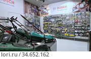 Panorama of shelves in a DIY shop with variety of power tools, mostly from the Bosch brand. Редакционное видео, видеограф Сергей Старуш / Фотобанк Лори