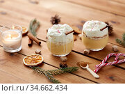 glasses of eggnog with whipped cream and spices. Стоковое фото, фотограф Syda Productions / Фотобанк Лори