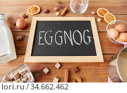 eggnog word on chalkboard, ingredients and spices. Стоковое фото, фотограф Syda Productions / Фотобанк Лори