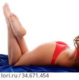 Playful brunette in erotic lingerie posing at camera. Стоковое фото, фотограф Zoonar.com/Andrey Guryanov / easy Fotostock / Фотобанк Лори