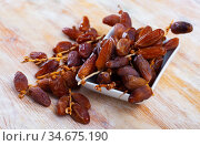 Fresh dates on wooden background, healthy snack. Стоковое фото, фотограф Яков Филимонов / Фотобанк Лори