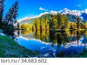 Magically beautiful park in the mountain resort of Chamonix. Large... Стоковое фото, фотограф Zoonar.com/kavram / easy Fotostock / Фотобанк Лори