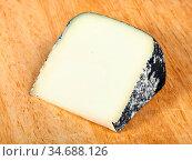Piece of local italian Perla Nera sheep's milk cheese on light wooden... Стоковое фото, фотограф Zoonar.com/Valery Voennyy / easy Fotostock / Фотобанк Лори