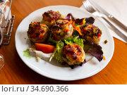Mushrooms stuffed with vegetables and ham, baked with mozzarella. Стоковое фото, фотограф Яков Филимонов / Фотобанк Лори