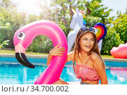 Portrait of girl with inflatable toy in swim pool. Стоковое фото, фотограф Сергей Новиков / Фотобанк Лори