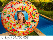 Girl pose with inflatable doughnut near swim pool. Стоковое фото, фотограф Сергей Новиков / Фотобанк Лори