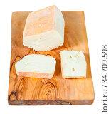 Sliced local italian Taleggio cheese from cow's full milk on olive... Стоковое фото, фотограф Zoonar.com/Valery Voennyy / easy Fotostock / Фотобанк Лори