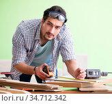 Woodworker working in his workshop. Стоковое фото, фотограф Elnur / Фотобанк Лори