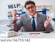 Businessman missing deadlines due to excessive work. Стоковое фото, фотограф Elnur / Фотобанк Лори