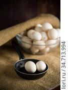 organic homemade fresh eggs in the pan under burlap. Стоковое фото, фотограф Peredniankina / Фотобанк Лори
