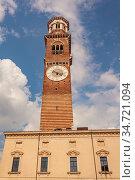 Lamberti tower in verona under a blue sky, vertical shoot. Стоковое фото, фотограф Zoonar.com/Filippo Carlot / easy Fotostock / Фотобанк Лори