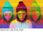 Art collage with alternative funky girl with overlay effect on bright multicolors background. Close up fashion portrait young beautiful woman in glasses. Unusual youth fashion concept. Стоковое фото, фотограф bashta / Фотобанк Лори