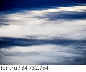 Abstrakte spiegelung von Wolken im Wasser des See. Стоковое фото, фотограф Zoonar.com/Ewald Fr / easy Fotostock / Фотобанк Лори