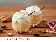 glasses of eggnog with whipped cream and cinnamon. Стоковое фото, фотограф Syda Productions / Фотобанк Лори