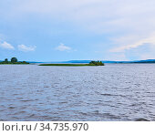 Small reed island in the middle of a wide river. Стоковое фото, фотограф Евгений Харитонов / Фотобанк Лори