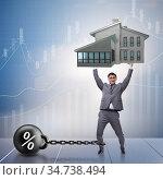 Businessman in mortgage debt financing concept. Стоковое фото, фотограф Elnur / Фотобанк Лори