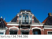 Hausgiebel in Friesland. Niederlande Workum. Стоковое фото, фотограф Zoonar.com/Gabriele Sitnik-Schmach / easy Fotostock / Фотобанк Лори