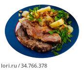 Appetizing fried pork with potatoes and herbs. Стоковое фото, фотограф Яков Филимонов / Фотобанк Лори