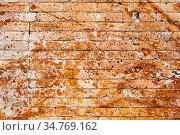 Background wall from an ancient yellow vintage brick with rusty corrosion... Стоковое фото, фотограф Zoonar.com/Ian Iankovskii / easy Fotostock / Фотобанк Лори