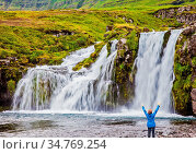 Elderly woman - traveler enthusiastically raised her hands. Waterfall... Стоковое фото, фотограф Zoonar.com/kavram / easy Fotostock / Фотобанк Лори