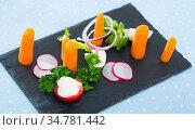 Close up of tasty dish of fresh vegetables and carrot dominant served. Стоковое фото, фотограф Яков Филимонов / Фотобанк Лори