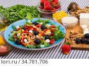 Salad with arugula, olives, Feta cheese, corn and walnut and its ingredients. Стоковое фото, фотограф Яков Филимонов / Фотобанк Лори