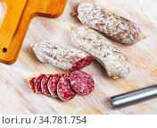 Sliced italian sausages salamini. Стоковое фото, фотограф Яков Филимонов / Фотобанк Лори
