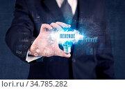 Businessman holding a light bulb with REVENUE inscription, new business... Стоковое фото, фотограф Zoonar.com/ranczandras / easy Fotostock / Фотобанк Лори