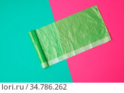 Green transparent plastic bag for garbage on a colored background... Стоковое фото, фотограф Zoonar.com/Danko Natalya / easy Fotostock / Фотобанк Лори