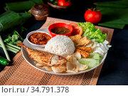Fried mackerel fish rice with sambal, popular traditional Malay or... Стоковое фото, фотограф Zoonar.com/szefei / easy Fotostock / Фотобанк Лори