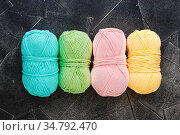 Colored skeins of yarn for crocheting or knitting, delicate colors... Стоковое фото, фотограф Zoonar.com/Burakova Irina / easy Fotostock / Фотобанк Лори