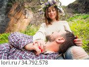 Hipster with a beard lies on the lap of his girl who wears a vinok... Стоковое фото, фотограф Zoonar.com/Ian Iankovskii / easy Fotostock / Фотобанк Лори