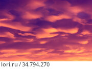 Colorful clouds of various shades on sunrise sky. Abstract and dramatic... Стоковое фото, фотограф Zoonar.com/Arthur Mustafa / easy Fotostock / Фотобанк Лори