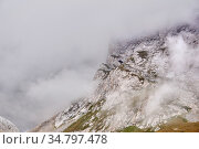 Steep rocky slope partially obscured by a cloud. Стоковое фото, фотограф Евгений Харитонов / Фотобанк Лори