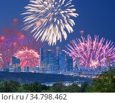 Fireworks over the Moscow city from Sparrow Hills or Vorobyovy Gory observation platform-- is on a steep bank 85 m above the Moskva river, or 200 m above sea level. Russia (2019 год). Стоковое фото, фотограф Владимир Журавлев / Фотобанк Лори