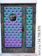 Vintage blue leather door with a window. Стоковое фото, фотограф Михаил Решетников / Фотобанк Лори