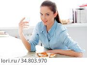 Morning. Attractive woman with delicious breakfast. Стоковое фото, фотограф Zoonar.com/Yeko Photo Studio / easy Fotostock / Фотобанк Лори