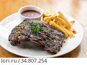 Grilled Barbecued Pork Baby Back Ribs with grilled sweet corn and... Стоковое фото, фотограф Vichaya Kiatying-Angsulee / easy Fotostock / Фотобанк Лори