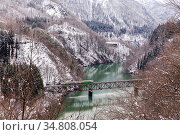 Train in Winter landscape snow on bridge. Стоковое фото, фотограф Vichaya Kiatying-Angsulee / easy Fotostock / Фотобанк Лори