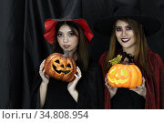 Two teenages and young adult girl women in Halloween costume for Halloween... Стоковое фото, фотограф Vichaya Kiatying-Angsulee / easy Fotostock / Фотобанк Лори