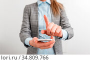 Business concept with mobile phone and business woman. Стоковое фото, фотограф Zoonar.com/Artur Szczybylo / easy Fotostock / Фотобанк Лори