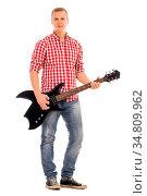 Young, calm musician with electric guitar. Стоковое фото, фотограф Zoonar.com/Yeko Photo Studio / easy Fotostock / Фотобанк Лори