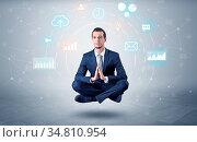 Elegant calm businessman levitates in yoga position with data circulation... Стоковое фото, фотограф Zoonar.com/ranczandras / easy Fotostock / Фотобанк Лори