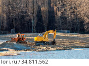 Excavator or digger and excavators working on ground. Industrial machinery... Стоковое фото, фотограф Zoonar.com/Viktoria Kondysenko / easy Fotostock / Фотобанк Лори